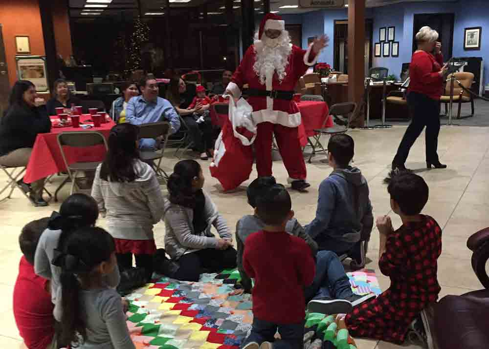 Santa visiting kids at our community event.